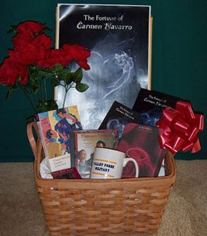 "The Fortune of Carmen Navarro basket: signed hardback copy of the novel; poster; red silk roses; VFMA mug; deck of ""Daring Ladies"" cards; RED themed stationary; Flamenco music CD; copy of classic novella Carmen & other stories, by Prosper Merimee."