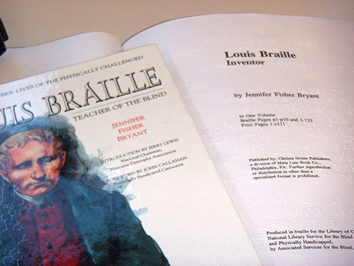 left, print version of 1994 biography; right, braille version